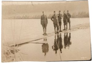 World War One (WWI): 5 soldiers standing at waters edge