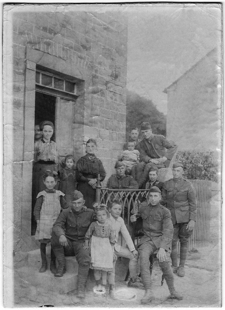 Robert E. Schalles with French family, circa 1918
