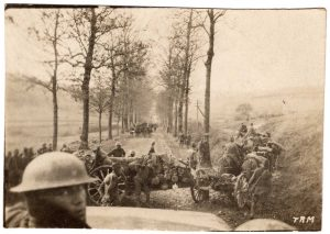 World War One (WWI): Cannons crossing a road being towed by horses.