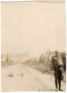 World War One (WWI): Soldier standing on a deserted road
