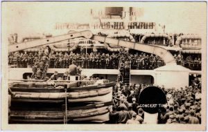Concert Time. Men crowded on deck of a ship