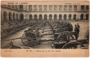Shows a bunch of cannons. Musee de L'armee. Camapgne 1914-1917. No. 352. Canons de 77 pris sur l'ennemi