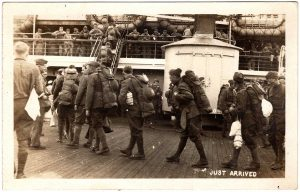 Just Arrived. Men walking on to the deck of a ship