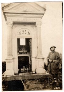Soldier next to large gravestone: Familie Carbon Paris