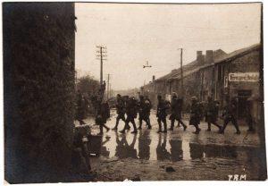 World War One (WWI): Soldiers walking across the street