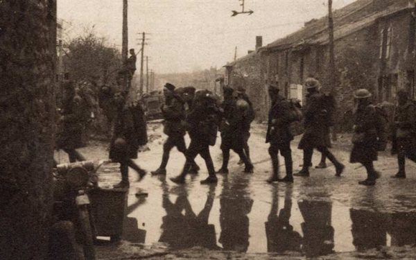 World War One soldiers marching through a city